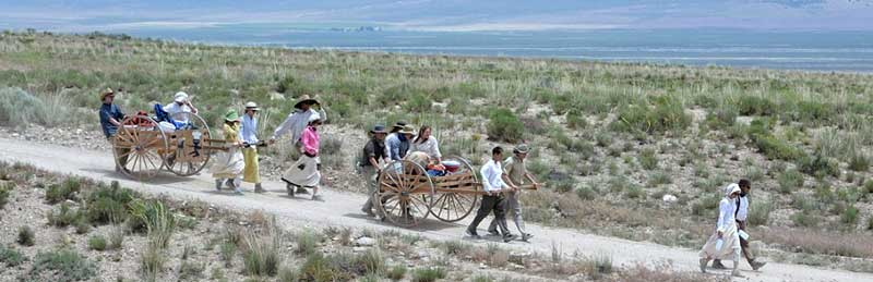 Mormons pulling handcarts, by by Hannah Cowan, Bureau of Land Management