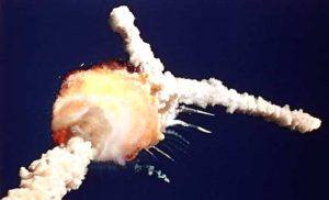 Space Shuttle Challenger explodes.