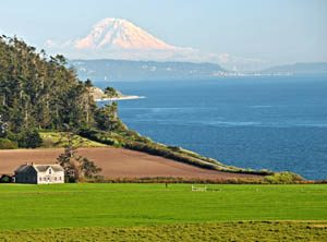 Ferry House at Ebey's Landing with Mt. Rainier in the background by the National Park Service.