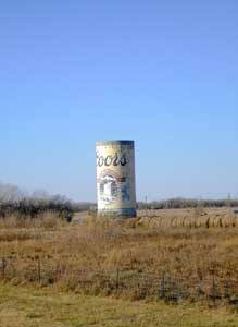 This silo painted to look like a Coors beer can stood near I-35 for years until it was removed to make way for a highway project. Photo by Kathy Weiser-Alexander.