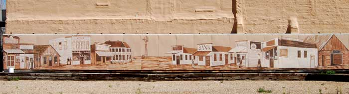A mural in Ulysses, Kansas depicts its history by Kathy Weiser-Alexander.
