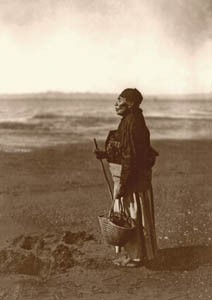 Chinook woman on the beach by Edward S. Curtis, 1910.