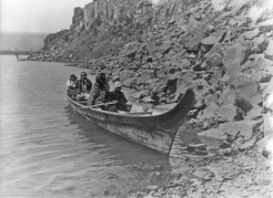 Chinook people in a canoe on the Columbia River.