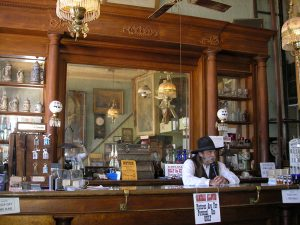 The bar at the Bird Cage Theatre in Tombstone, Arizona by Kathy Weiser-Alexander.