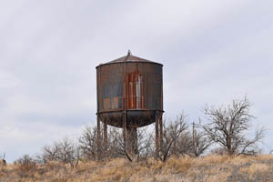 Old railroad water tower in Hachita, New Mexico by Kathy Weiser-Alexander.