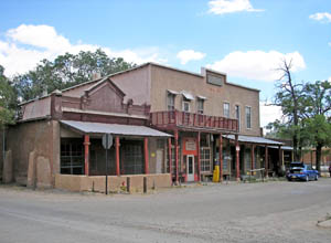 The old Simoni Store and Wortley Hotel on Front Street in Los Cerrillos, New Mexico by Kathy Weiser-Alexander.