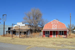 Old business buildings in May, Oklahoma by Kathy Weiser-Alexander.