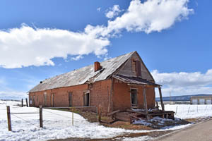 Large abandoned building in Ocate, New Mexico by Kathy Weiser-Alexander.