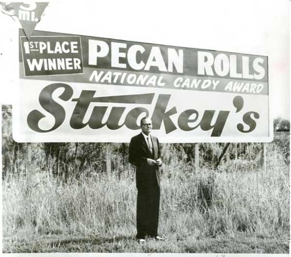 W.S. Stuckey in front of Billboard